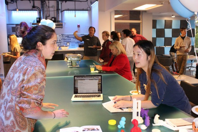 Students discuss possibilities for using the new makerspace in Carmichael Residence Hall.