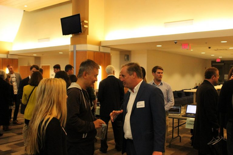 UNC entrepreneur-in-residence Jim Kitchen networks with pitch party attendees.