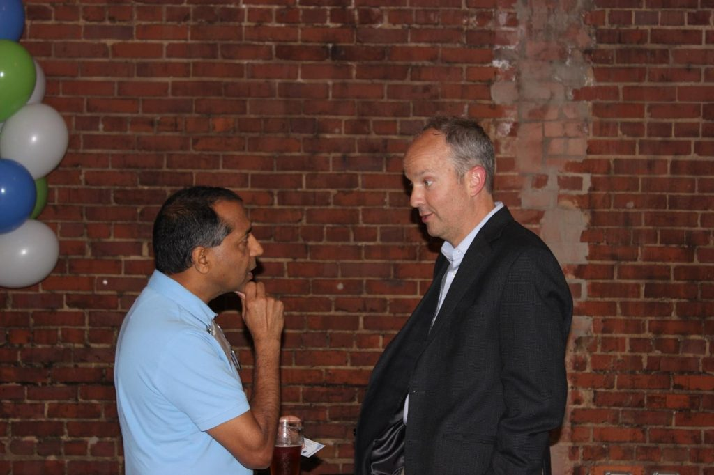Mark Schoenfisch (right) meets with colleagues during the Celebration of Inventorship reception