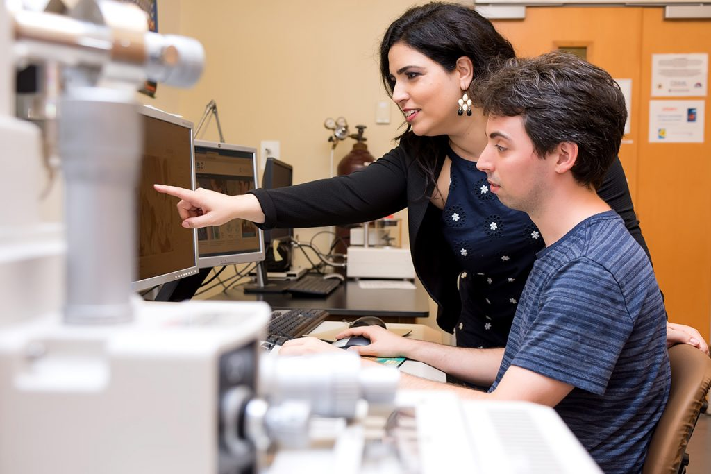 Dr. Freeman and her student using the electron microscope.