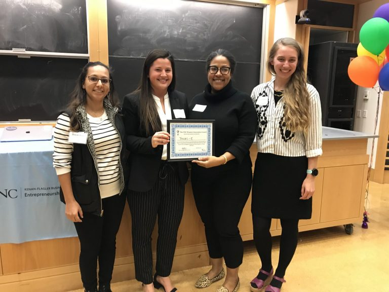 Doctoral student Denali Dahl (left) from the UNC Women's Innovation Council presents the Travel-E team with an award for the best women-founded venture
